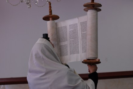 Raising the Sefer Torah, via Wikimedia Commons